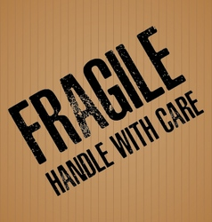 Fragile with Handle with care on brown cardboard vector image