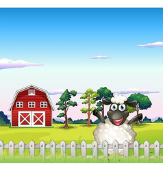 A happy sheep near the barn vector image vector image