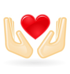 Charity and care concept - hands with heart vector