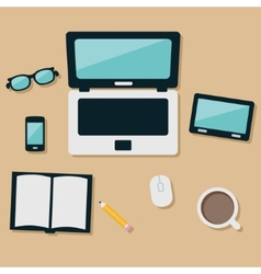 Laptop and equipments on the table vector