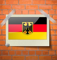 Flags germany scotch taped to a red brick wall vector