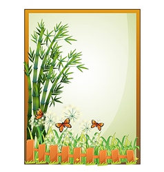A frame with bamboo plants and butterflies vector image vector image