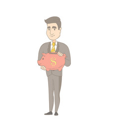 Young caucasian businessman holding a piggy bank vector