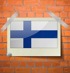 Flags finland scotch taped to a red brick wall vector