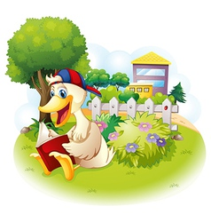 A duck reading at the garden with a fence vector