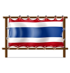The flag of thailand attached to the wooden frame vector