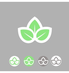 Green leaves ecology symbol template logo design vector