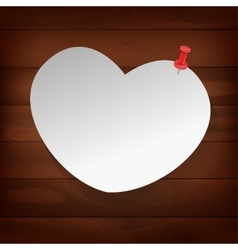 Pinned heart on wood vector