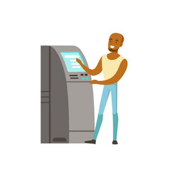 Young black man using cash atm machine vector