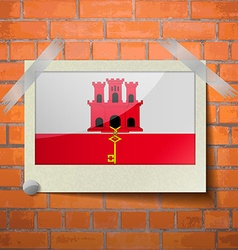 Flags Gibraltar scotch taped to a red brick wall vector image