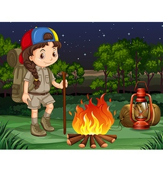 Little girl standing by the campfire vector