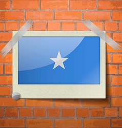 Flags somalia scotch taped to a red brick wall vector
