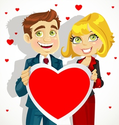 Cute man and woman holding a valentine vector image