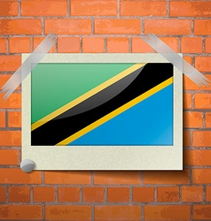 Flags tanzania scotch taped to a red brick wall vector