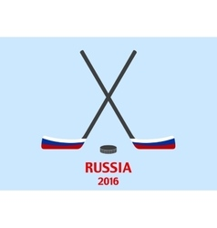 Hockey sticks and puck with the russian flag vector