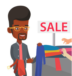 young man choosing clothes in shop on sale vector image vector image