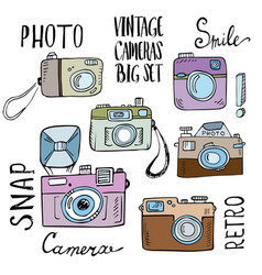 Hand drawn set of retro cameras with lettering vector