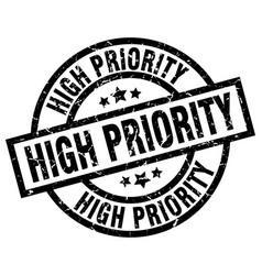 High priority round grunge black stamp vector