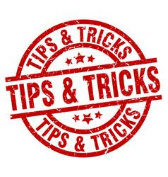 Tips tricks round red grunge stamp vector