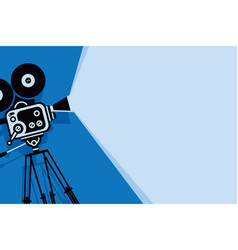 blue background with old fashioned movie camera vector image