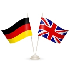 Table stand with flags of england and germany vector