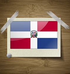 Flags dominican republic at frame on wooden vector