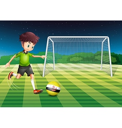A football player kicking the ball with the flag vector