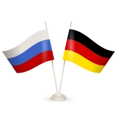 Table stand with flags of russia and germany vector