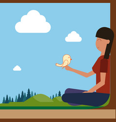 Girl sitting on groud outdoors hold bird on hand vector