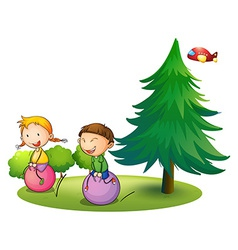 Kids playing with the bouncing balloons near the vector image