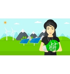 Woman holding lightbulb with windmills inside vector