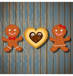 Loving couple of gingerbread and heart cookie vector
