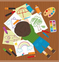 Boy draws on the floor vector