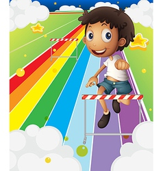 A little boy near the stripe hurdle vector image