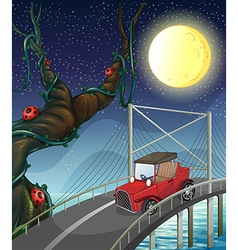 A vintage car passing across the bridge vector