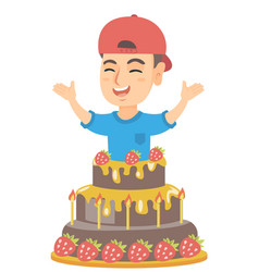 little caucasian boy jumping out of a large cake vector image