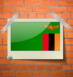 Flags zambia scotch taped to a red brick wall vector