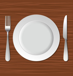 Blank Plate Fork and Knife on Old Wooden Table vector image