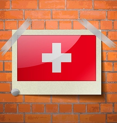 Flags switzerland scotch taped to a red brick wall vector