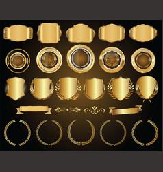 Golden shields laurel wreaths and badges vector
