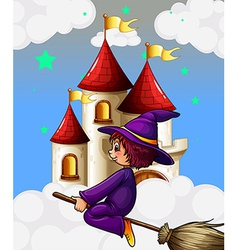 A witch riding in a broom near the castle vector
