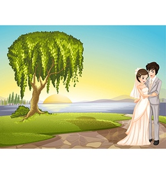 A couple across the tree vector