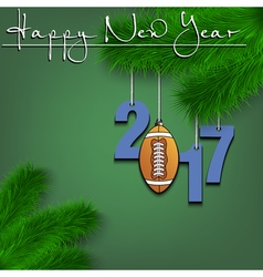 Football ball and 2017 on a christmas tree branch vector