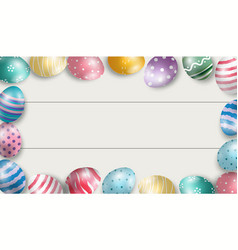 Colorful easter eggs with white wooden background vector