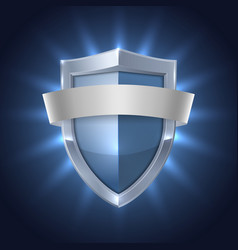 Glowing shield with blank ribbon safety badge vector
