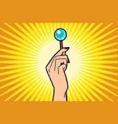 Lollipop in female hand vector