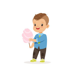 Stylish preschool kid standing with sweet cotton vector