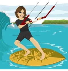 Female kiteboarder enjoys surfing waves vector