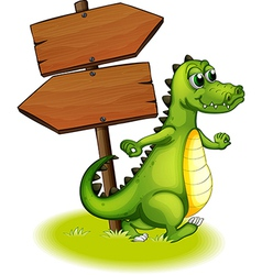 A crocodile beside the wooden empty arrowboard vector image vector image