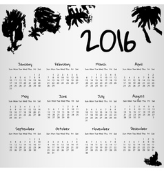 2016 calendar with some inkblots on white vector